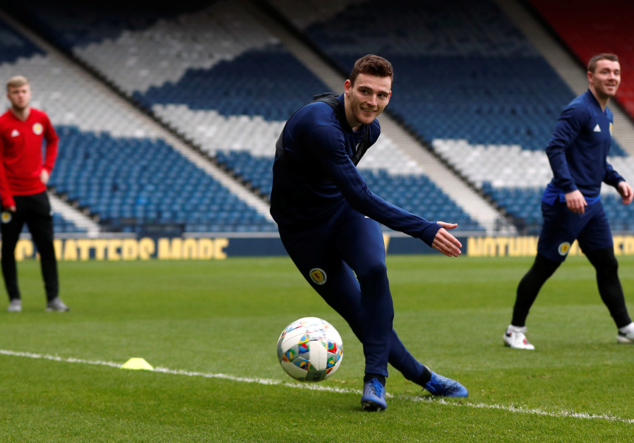SCOTLAND'S ANDREW ROBERTSON prepares for the match against Israel yesterday at Hampden Park