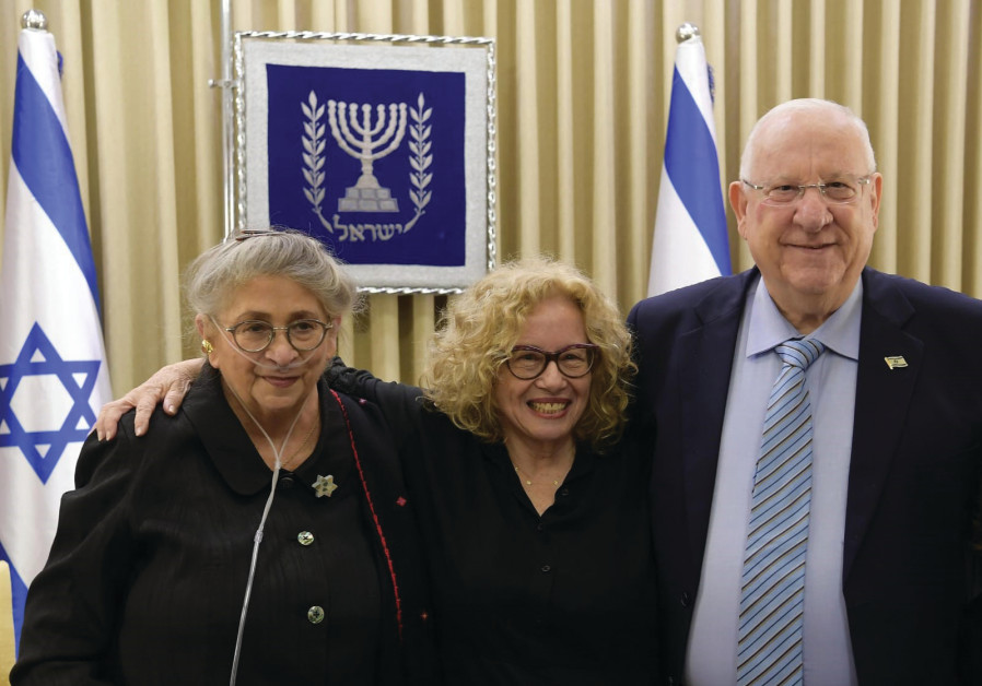 CHAVA ALBERSTEIN, flanked by President Reuven Rivlin and his wife, Necham