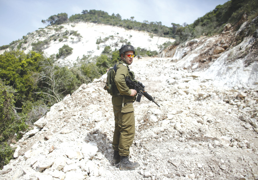AN IDF soldier on guard – the enemy on one side and attorneys on the other?
