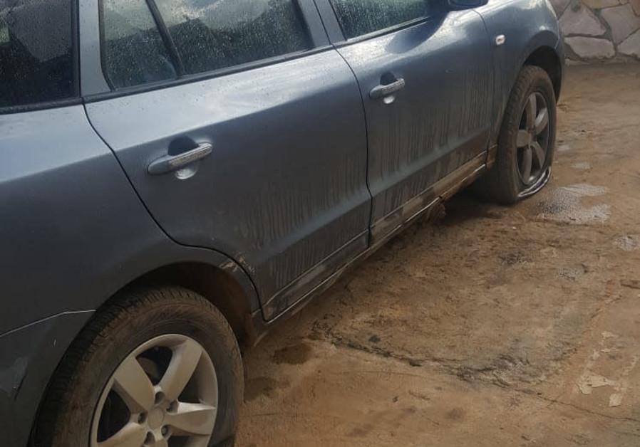 Vandals punctured tires on a car in the village of El Muar.