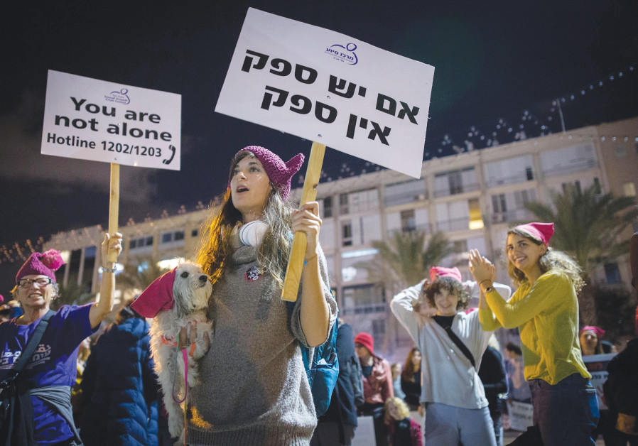 Demonstrators in Tel Aviv protest violence against women during a rally last night, protesting the Internat
