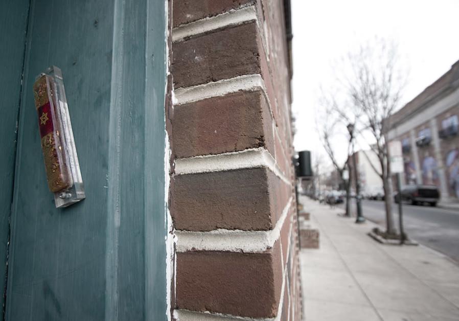 Mezuzah affixed to a door frame on South Street in Philadelphia.
