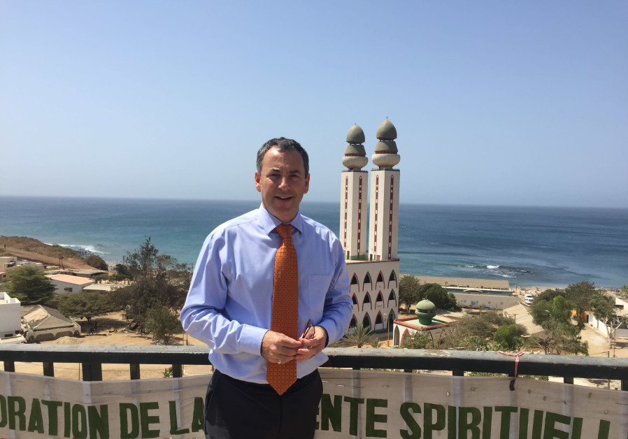 AMBASSADOR PAUL HIRSCHSON in front of the iconic Mosque of the Divinity in Dakar
