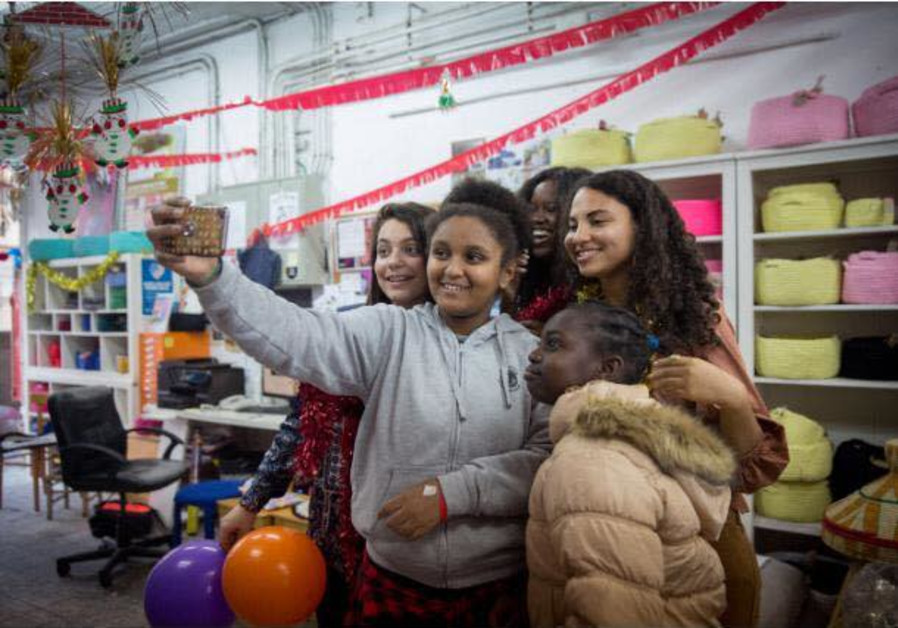 Sylvana Tsegai takes a selfie at the  Kuchinate, African Refugee Women's Collective's Christmas part