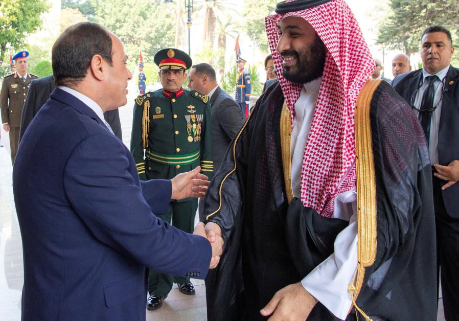 Saudi Arabia's Crown Prince Mohammed bin Salman shakes hands with Egyptian President Abdel Fattah al