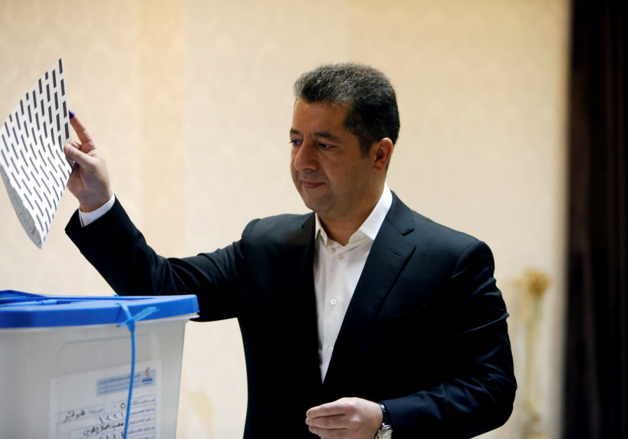 Iraqi Kurdish security chief Masrour Barzani, casts his vote, during parliamentary elections in the