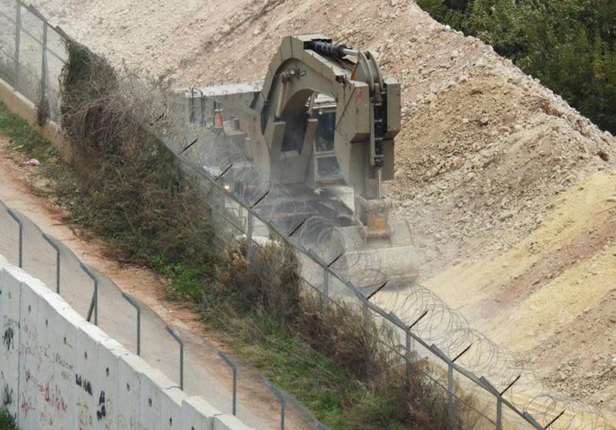Israeli vehicle digs at the border near the village of Kfar Kila, in south Lebanon December 4, 2018