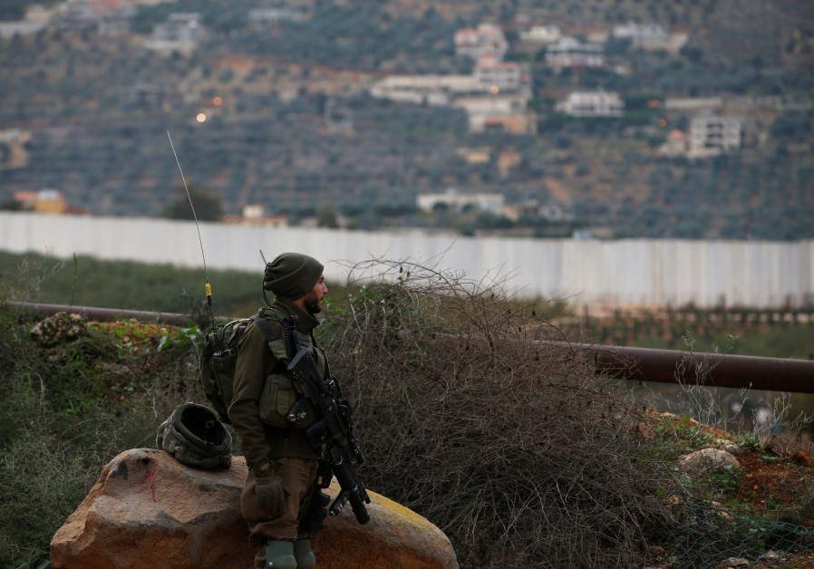 An Israeli soldier guards near the border with Lebanon, the morning after the Israeli military said