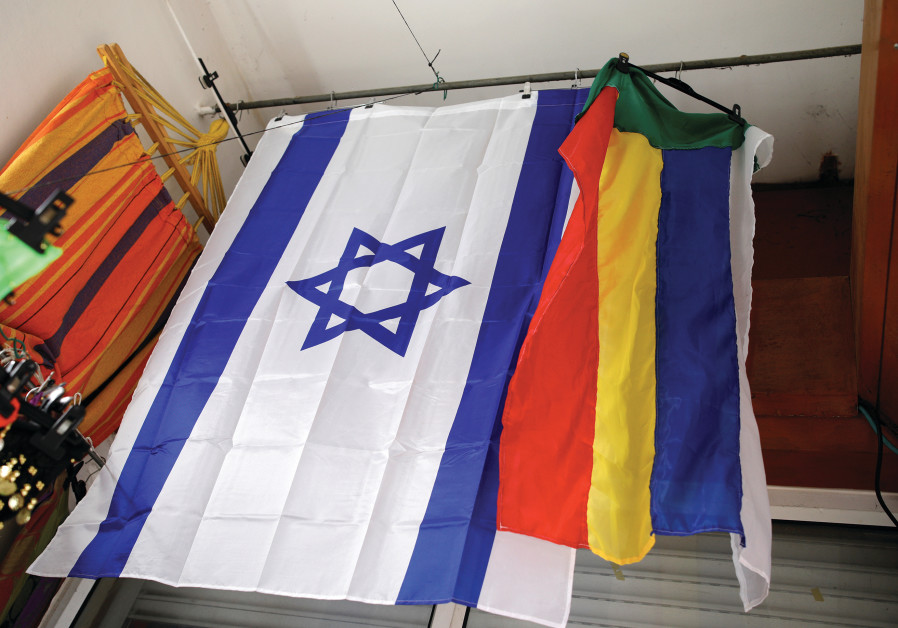 AN ISRAELI and a Druze flag hang from the ceiling of a store in the Druze town of Daliat al-Karmel.