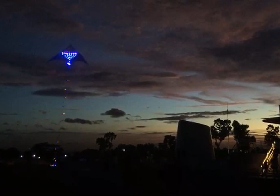 Singapore mounts a menorah on a kite and flew it through the skies of the country