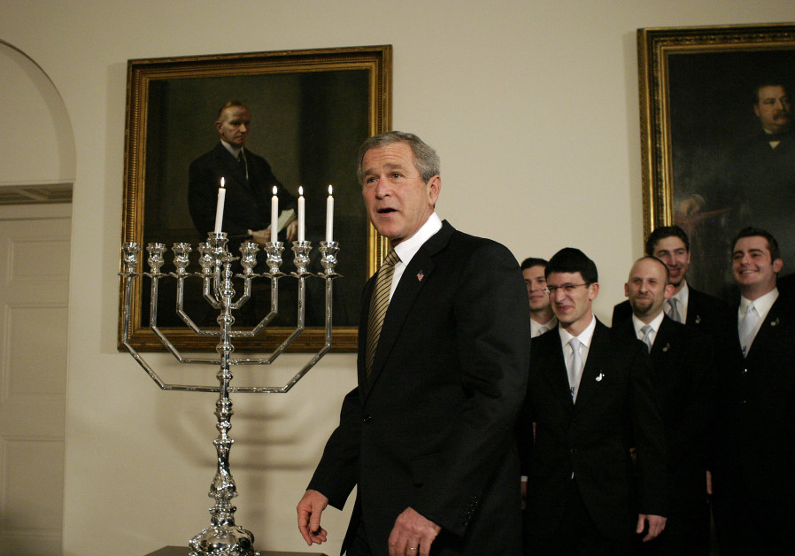 U.S. President George W. Bush looks on after a menorah was lit for Hanukkah at the White House