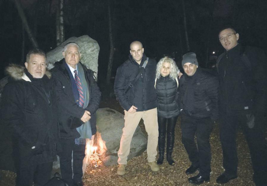 YITZHAK ELDAN, with Israeli high school students and friends following the lighting of the hanukkiah