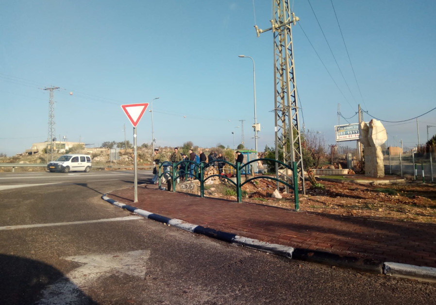 The intersection outside of Ofra, the morning after a terrorist attack left seven injured, December