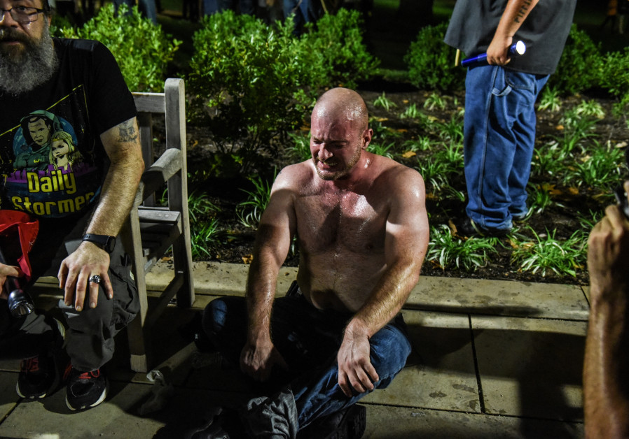 Christopher Cantwell recovers from being pepper-sprayed as he and other white nationalists participa