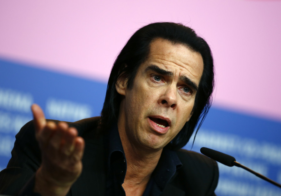 "Cast member Nick Cave talks during a news conference promoting the movie ""20,000 Days on Earth"" at t"