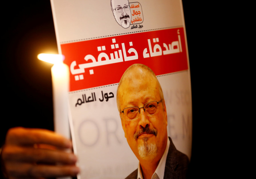 A demonstrator holds a poster with a picture of Saudi journalist Jamal Khashoggi outside the Saudi
