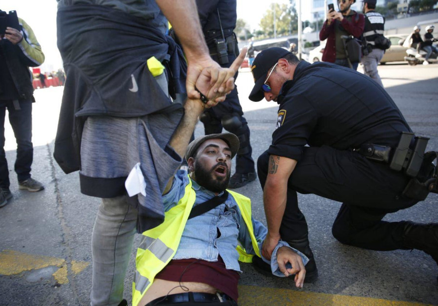 "A demonstrator is arrested at a ""Yellow Vest"" protest in Tel Aviv, December 14, 2018"