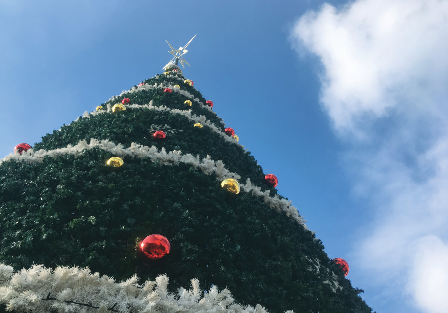 A CHRISTMAS TREE stands at Mar Elias Church for the Christmas-Suta festival