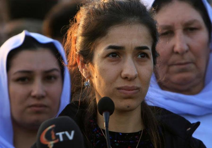 Nobel Peace Prize laureate, Yazidi activist Nadia Murad talks to people during her visit to Sinjar.