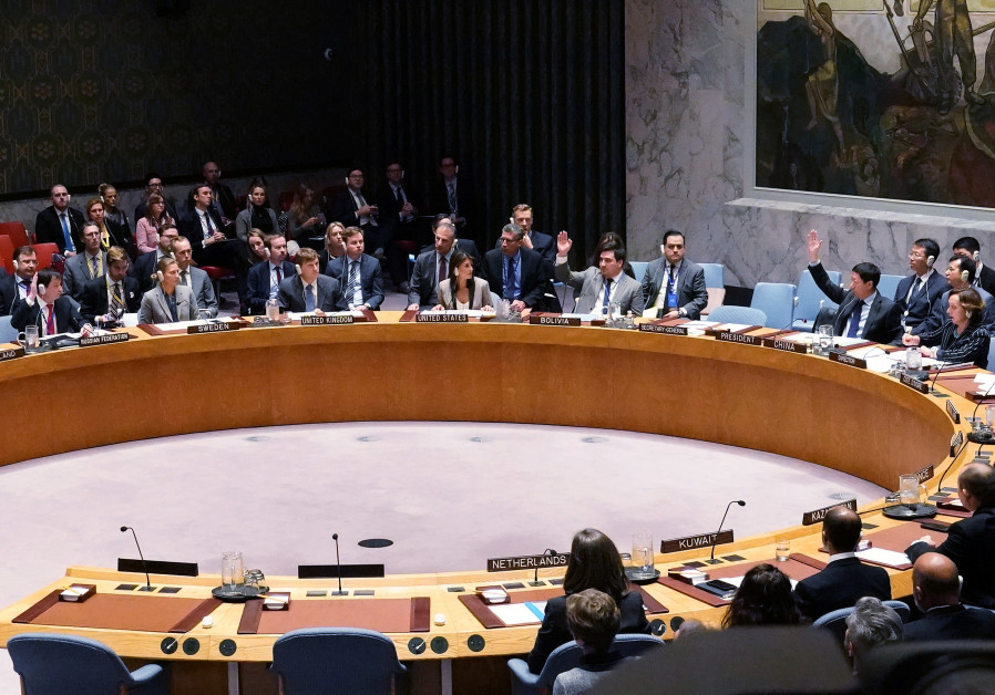Members vote during a meeting of the United Nations Security Council about the situation in Crimea a