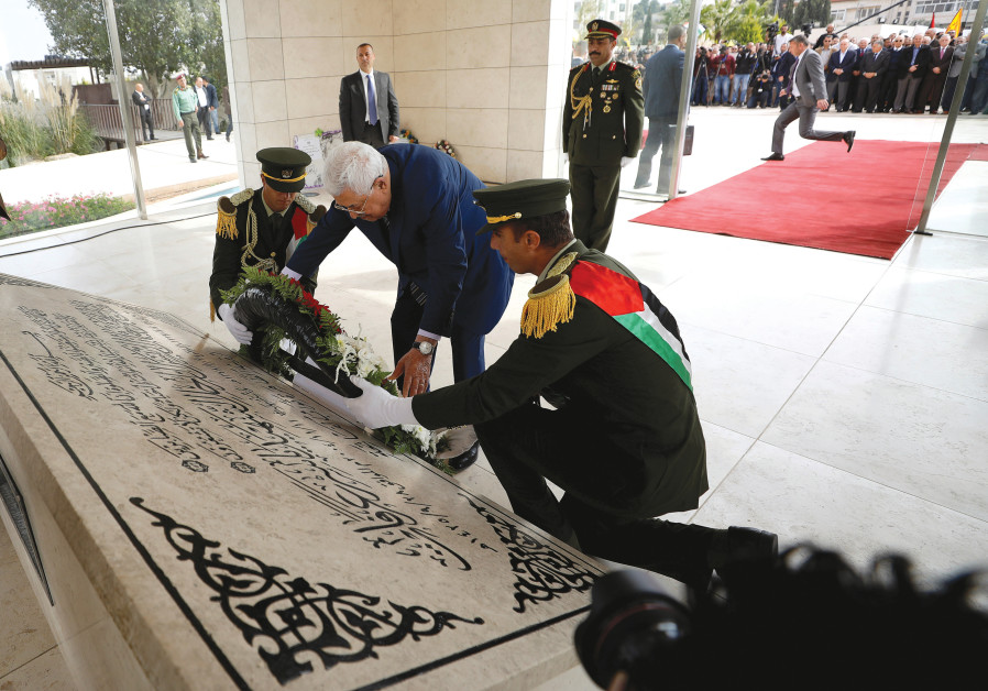 PALESTINIAN AUTHORITY President Mahmoud Abbas lays a wreath on the tomb of late Palestinian leader Y