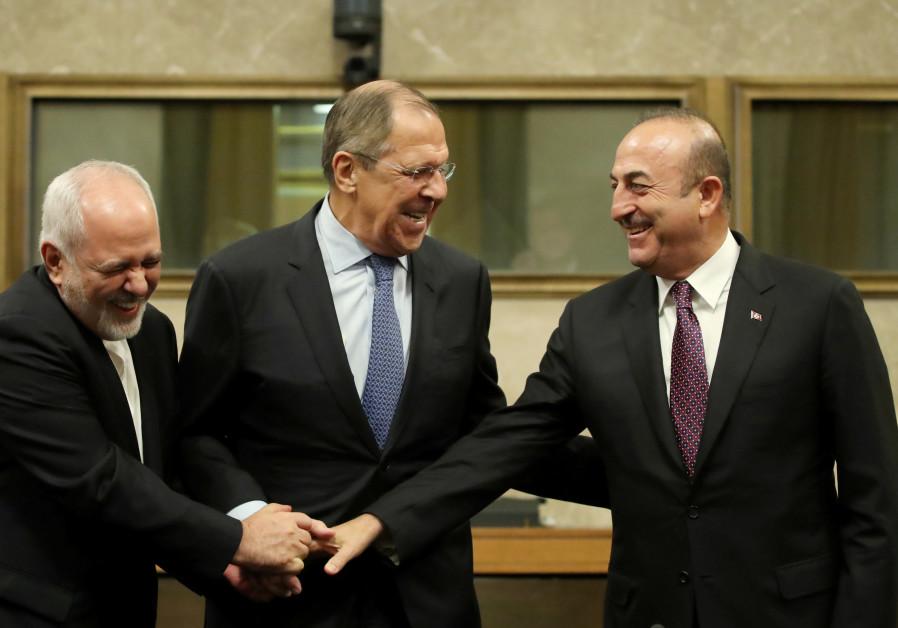 Russia's Sergei Lavrov, Turkish Foreign Minister Mevlut Cavusoglu and Iran's Javad Zarif