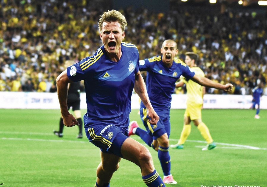 AARON SCHOENFELD (front) and Maccabi Tel Aviv face a tough test on Saturday