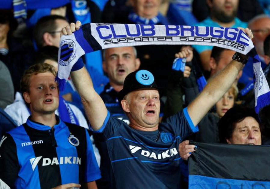 Club Brugge fan holds up a scarf