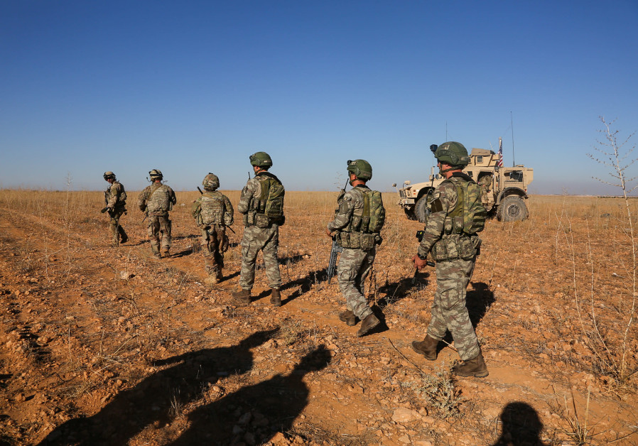 U.S. and Turkish soldiers conduct the first-ever combined joint patrol outside Manbij, Syria, Novemb