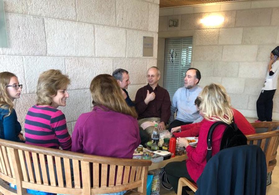 Father of soldier Nathaniel Felber sits next to David Hager at Hadassah Ein Karem Hospital