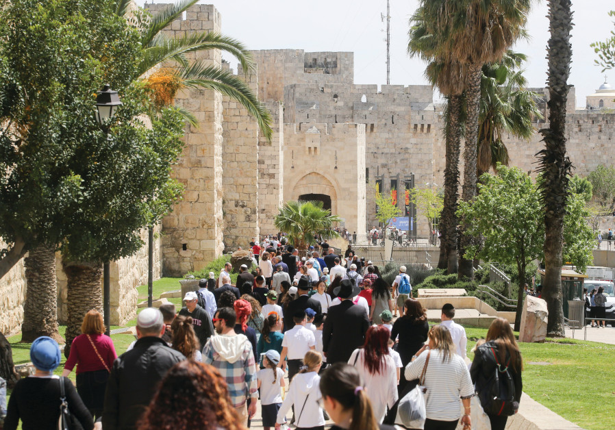 TOURISTS THRONG to Jerusalem's Old City in record numbers.