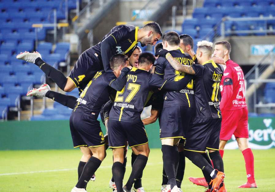 BEITAR JERUSALEM players celebrate their team's second goal in a 3-0 surprise road victory over Hapo