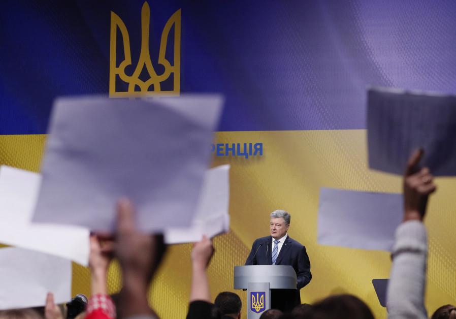 Ukraine's President Petro Poroshenko speaks during the news conference in Kiev.