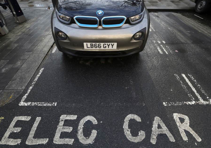 A car is parked at a charging point for electric vehicles in London, Britain, March 6, 2018.