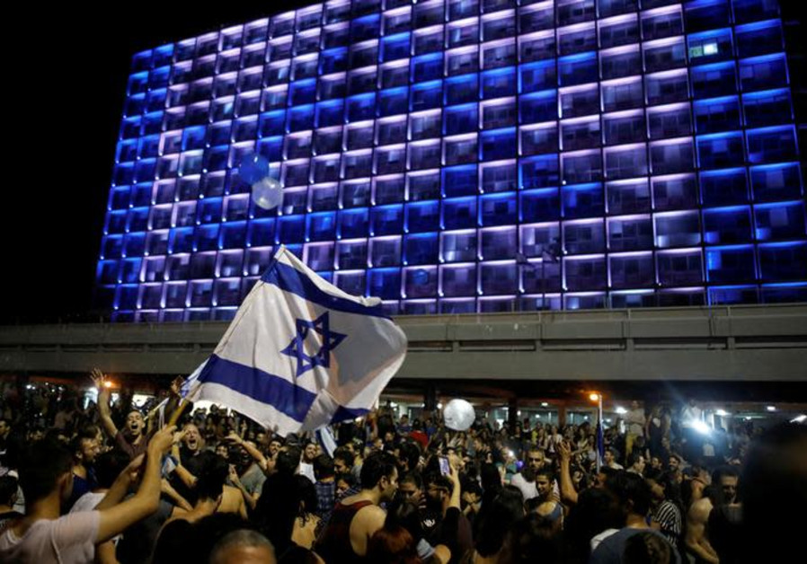 People celebrate the winning of the Eurovision Song Contest 2018 by Israel's Netta Barzilai.