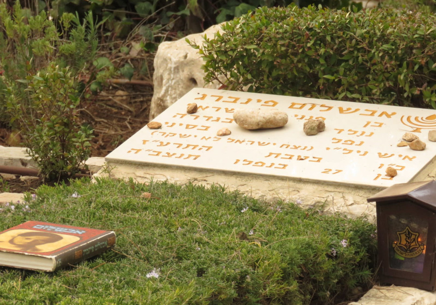 Stones laid in memory of Avshalom Feinberg by right-wing NGO Im Tirtsu members.