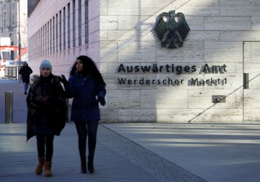 People walk past the seat of the German Foreign Ministry in Berlin, Germany, March 1, 2018.