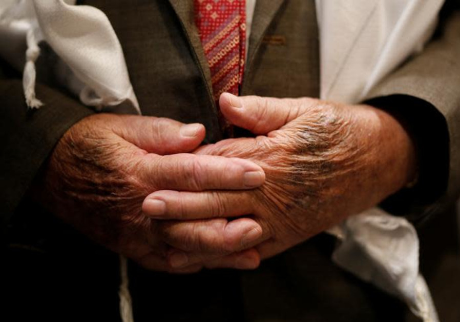 The hands of Shalom Shtamberg, a 93-year old Holocaust survivor, are seen during his bar mitzvah