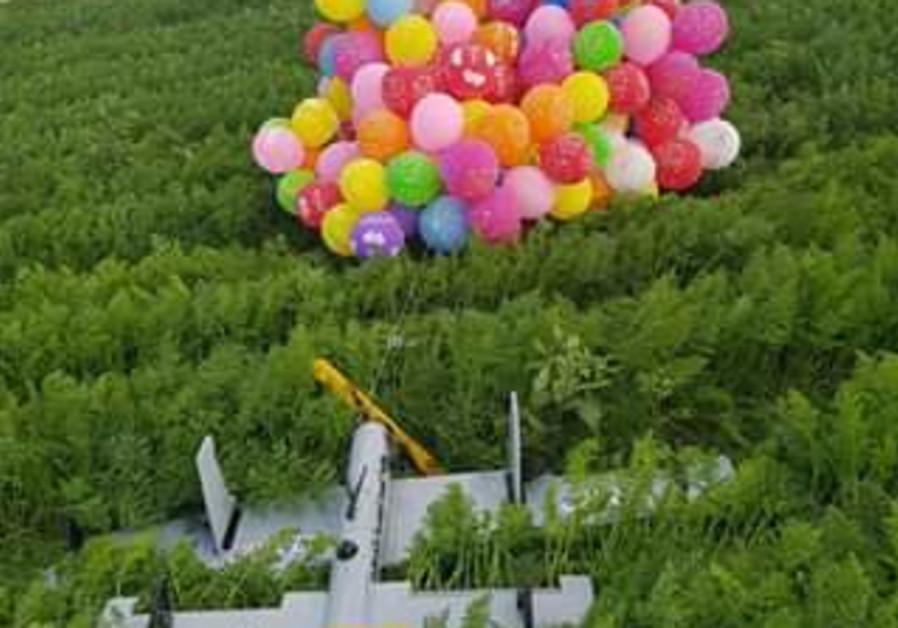 Israel hits Hamas posts after incendiary balloons, drone fall near border