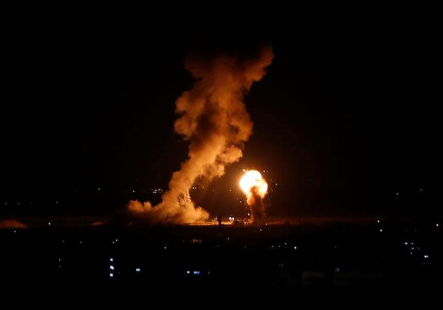 Smoke and flame are seen during an Israeli air strike in Gaza, November 12, 2018