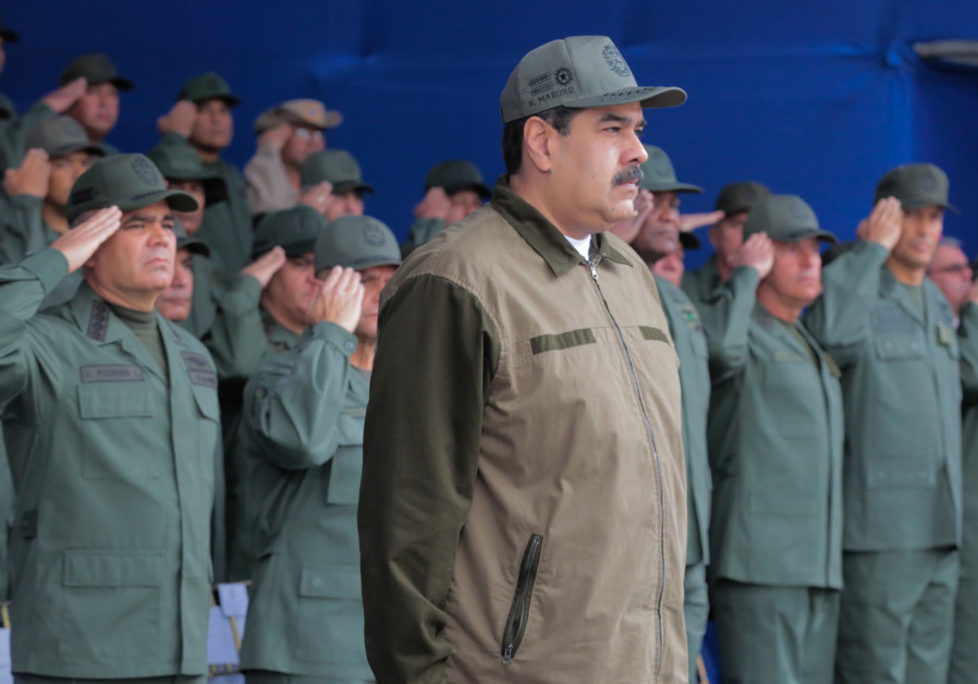 Venezuela's President Nicolas Maduro attends the end of the year ceremony with members of the Boliva