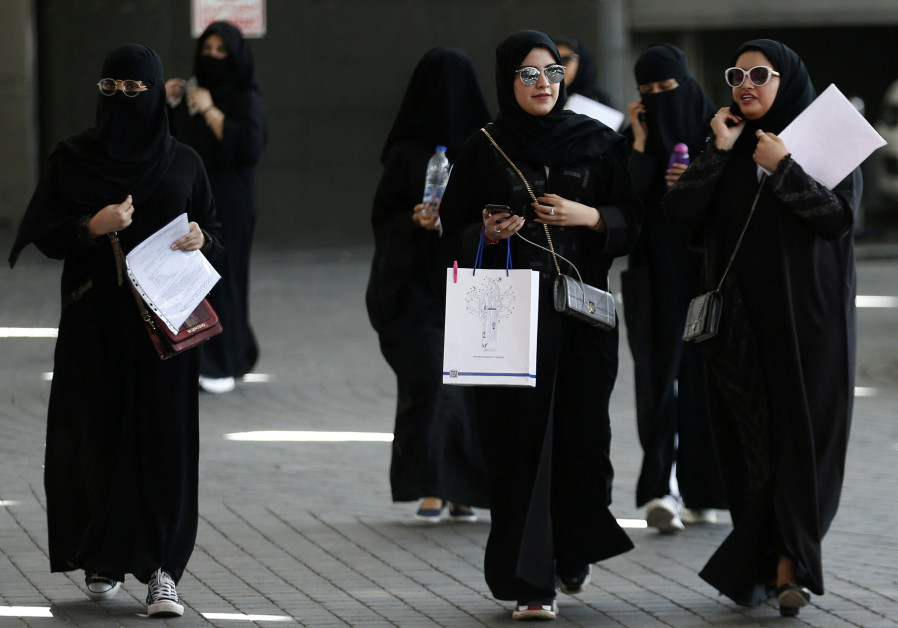Saudi students walk at the exhibition to guide job seekers at Glowork Women's Career Fair in Riyadh
