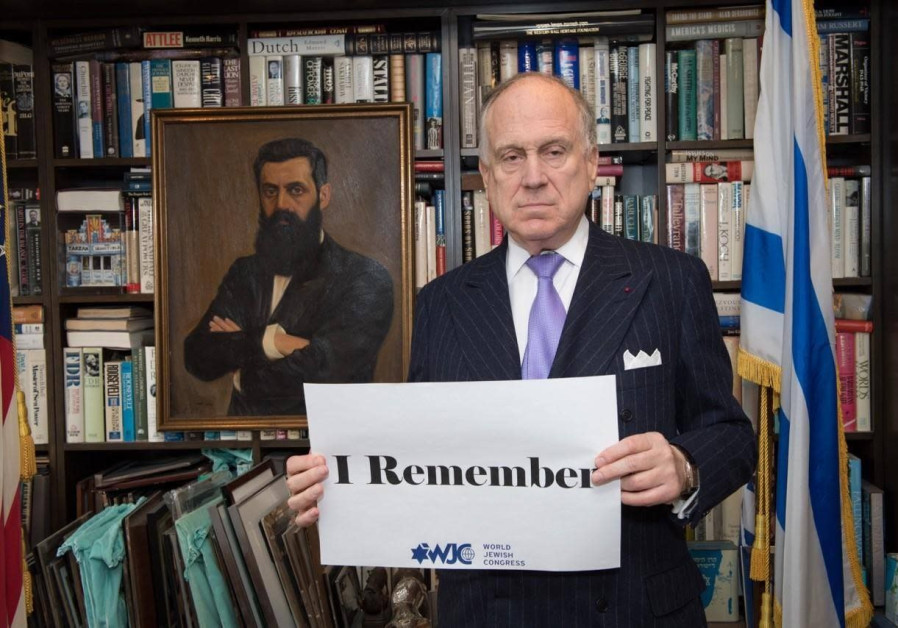 WORLD JEWISH CONGRESS President  Ronald Lauder holds a #WeRemember sign