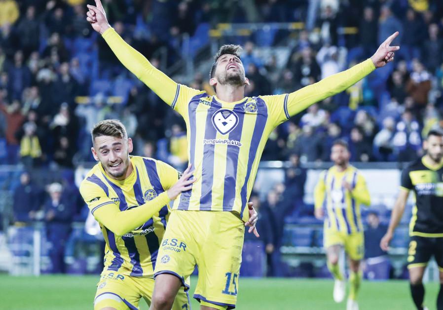 Maccabi Tel Aviv's Dor Micha (front) celebrates with teammate Omer Atzili