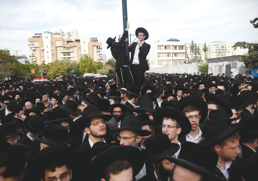 ULTRA-ORTHODOX Jews gather during a funeral ceremony in Bnei Brak.