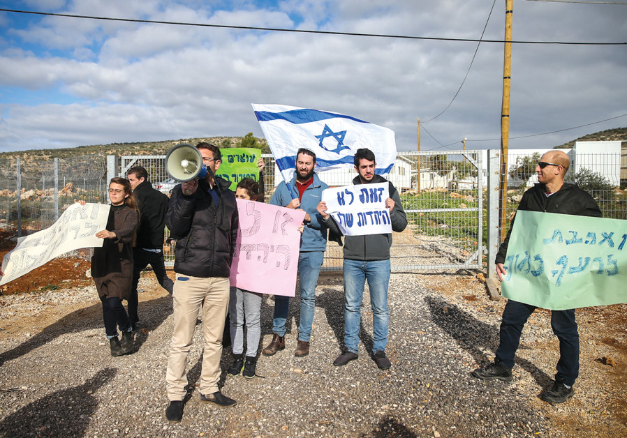 Protesters demonstrate at the entrance to Rehelim against Jewish youths from the nearby Pri Ha'aretz