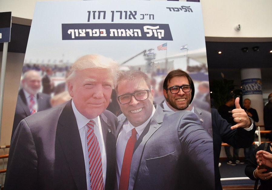 Oren Hazan posing with a poster of his selfie with US President Donald Trump at the Leumiada