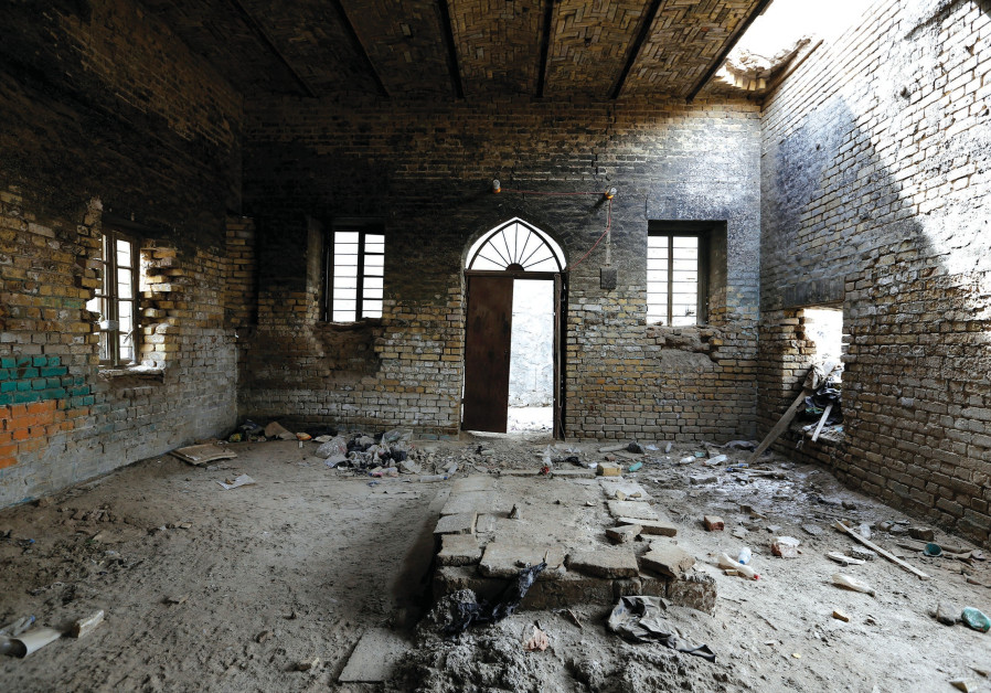 THE INTERIOR remains of a synagogue are seen in the center of Baghdad