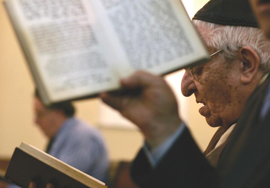 MOROCCAN JEWS pray at a synagogue in Tetouan, Morocco