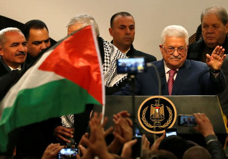 Palestinian Authority President Mahmoud Abbas gestures during a ceremony